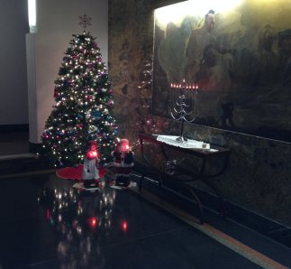 Sparkling lights in the lobby bathe Mr. & Mrs. Claus.
